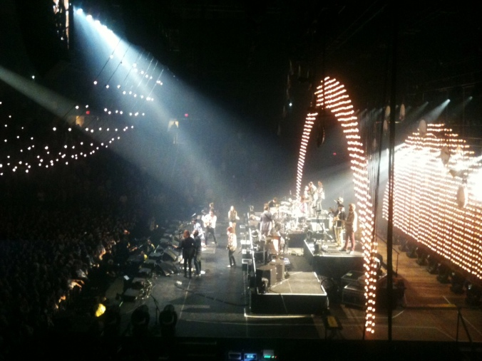 "Mumford and Sons performing ""The Weight"" with their opening bands in the finale. It gives you a pretty good idea of my view for the night."